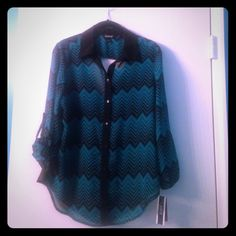 A. Byer chevron blouse 3/4 sleeve green/black button up blouse. Chevron pattern. Sleeves can be worn down or buttoned up. Back is mostly see through black, draped material shows off your back (see pic 3)  Never worn has tags attached. A. Byer Tops Button Down Shirts