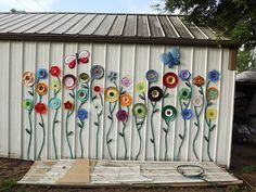 Thrift store finds and garden hose. Crafty flower art on the shop wall.
