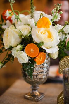 orange centerpiece, photo by Pill Photography, styling by Belovely Designs http://ruffledblog.com/city-glam-country-inspiration-with-freixenet #flowers #weddingflowers #centerpieces