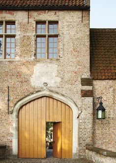 Centuries-old Building: Restoring a manor near Bruges brings forth centuries of storied design.