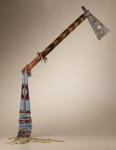 Native American:Weapons, Crow Tomahawk with heart cutout and beaded and fringed pendant.Circa 1890. Length 51 1/4 in. overall; Length 8 1/2 in. the ...