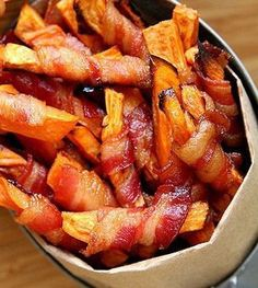 Bacon wrapped sweet potatoes #Paleo... How to get Chris to eat sweet potatoes...
