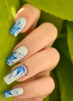 Blue floral nail art.