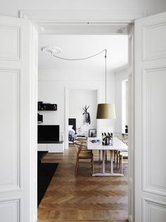Scandinavian dining. Particularly love the herringbone flooring! This has the border to break it up