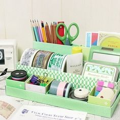 Desk organizer made from shoe boxes and shoe box lids.