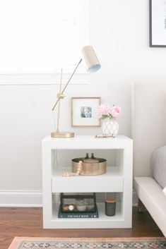 This bright and light room comes together with white nightstands from Serena & Lily. Love the colorful oriental rug and the sleek black frames over the beige headboard. White Bedroom, Modern Bedroom, Master Bedroom, All White Room, White Furniture, Bedroom Furniture, Furniture Dolly, Plywood Furniture, Diy Furniture