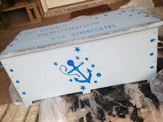 """Ratty old chest painted and given the look of a vintage foot locker.  Chalk paint and a painstakingly hand cut stencil for the anchor.  On the top it says """"to sleep perchance to dream:"""
