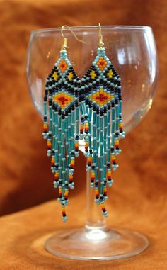 Turquoise Fire Inspired Native Beaded earrings by Midnightsundesign on Etsy