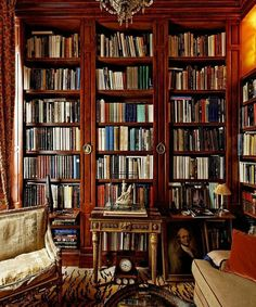 ⌘ Lovely library.  I like the closed bookcases