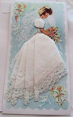 Our bridal wedding favor hankie cards feature a beautiful handkerchief folded to create lovely hanky dress. Each hankie card is wrapped individually in cello and includes a white envelope for mailing