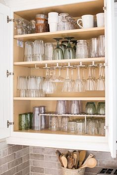 How to Organize Your Glassware Cabinet Once and For All | TheInspiredHome.com #cleaning #organization #glassware #kitchen #declutter via @ihainspiredhome
