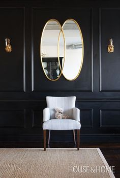 Family Room: Dark painted paneling and seagrass carpeting on floor.  Brass hardware on bookcase w/starburst knobs on doors and starburst chandelier fixture.