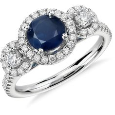 Blue Nile Isola Sapphire and Diamond Halo Three Stone Ring ($2,900) ❤ liked on Polyvore featuring jewelry, rings, 3 stone sapphire ring, halo diamond ring, charm jewelry, 14k ring and 14k jewelry