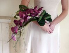 Dark Purple Lillies Centerpieces | fusion bollywood Inc wedding blog: Wedding flower trends 2012
