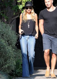 Signature Style: Nicole Richie: On a casual outing in LA, Nicole relies on her bell-bottoms, fedora, House of Harlow jewels, and Balenciaga motorcycle bag for that quintessential vintage-inspired cool.