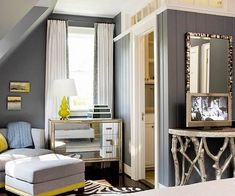 slate + charteuse: bedroom in deep tones of slate gray. sm chair and ottoman in lighter gray with chartreuse trim + pillow bring in a warm hue. mirrored dresser adds glamour, zebra rug and pops of chartreuse make it cozy and welcoming