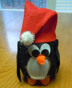 Christmas craft ideas, turn a recycled water bottle into a Christmas penguin