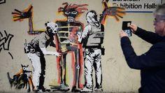 Banksy omaggia Basquiat:due murales sul muro del Barbican