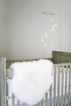 Baby W's nursery // Elks and Angels sheepskin rug // Restoration Hardware mobile + crib.