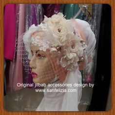 One of Wedding Hijab/Jilbab I've made. It's a semi-birdcage veil Hijab accessory. Made with pearls, fabric flowers and brocade/lace. It's a sold-out item, but if you want this model of headpiece, feel free to contact me through Whatsapp or Email. I can always able to make another beautiful head accessory for you, dear Bride gonna be! ;) #headpiece #hijab #jilbab #headaccessory #crystal #flower #birdcageveil #veil #floral
