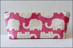 A flat bottom pencil case using lovely elephant fabric . Make a pouch, purse or wallet in under 60 minutes by sewing with fabric and zipper. Inspired by elephants. Elephant Fabric, Cute Elephant, Diy School Supplies, Diy Supplies, Clutch Purse, Coin Purse, Cute Sewing Projects, Diy Projects, Cute Flats