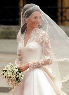 The veil was made of layers of soft, ivory silk tulle with a trim of hand-embroidered flowers, which was embroidered by the Royal School of ...