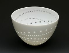 Niisato Akio - I adore this. Am also imagining it with a different coloured glaze on the inside so you'd get translucent coloured dots from the outside.