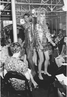 """Paco Rabanne, fall 1968 collection: """"The Water"""" (left) and """"The Fire,"""" (right) minidresses made of gold and silver plates. © AP/Wide World Photos."""