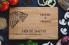Personalized Cutting Board Dinner is coming Games of thrones House Stark Direwolf Engraved Custom Family chopping Wedding Gift Anniversary Housewarming Birthday. Game of Thrones Gifts For Her. Game of Thrones Gifts For your girlfriend. Game of Thrones  Gift Ideas. Game of Thrones Gift Guide. Affiliate Link.