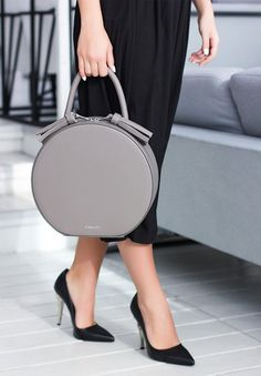 Color: Gray Material: Calf leather Brunto Zip-fastener Solid handle 12cm height Sections / pockets (internal): 1 section, 2 pockets, one with zipper. Hand-paint