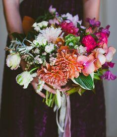 dahlias, snow berries, hellebores, piano garden roses, clematis, orchids, pieris, parrot tulips, hosta leaves, liquid amber, and magnolia