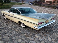 '59 Chevrolet Impala . We would borrow my dad's car and  go to the drive in theatre.  Same model, same colour.