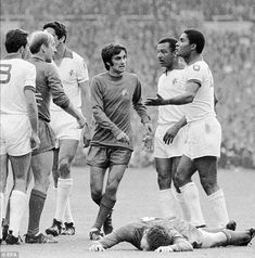 Plenty to talk about: George Best (centre) has words with Eusebio (right) after a United player is felled