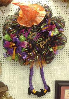 Deco Mesh Wreath with witch legs and hat. Awesome way to spice up your halloween decor! #halloween #benfranklinonline