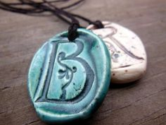 Items similar to Monogram Essential Oil Diffuser Necklace, Off White or Blue Green Aromatherapy Ceramic Letter Pendant, Romantic Nature Clay Jewelry on Etsy Ceramic Pendant, Ceramic Jewelry, Ceramic Beads, Ceramic Clay, Ceramic Pottery, Diffuser Jewelry, Diffuser Necklace, Spoon Jewelry, Jewelry Art