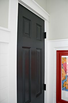 Another door goes black!) from Thrifty Decor Chick How to paint interior and exterior doors and the color I use for the black doors in our home. Painted Interior Doors, Black Interior Doors, Painted Doors, Wood Doors, Interior Paint, Home Interior, Modern Interior, Interior Decorating, Interior Design