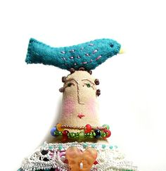 Handmade cloth art doll with a teal bird on top by theresahutnick, $30.00