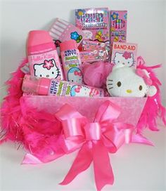 Hello Kitty Gift Basket for Girls  All little girls LOVE Hello Kitty!  A pink container holds all sorts of Hello Kitty Gifts.   Little girls will love this gift because it is full of all things Hello Kitty!  We've included some pretty special things to keep your little girl very busy.  www.GrandGiftsOnline.com