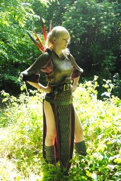 Green skirt slit at the sides, pop tab chain mail front thingy, brown shirt (baggy button up would do), craft foam pauldrons, foam or paper mâché breastplate, belts, craft foam gauntlets. Sexy warrior elf