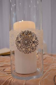 Decorations Tips, Vintage Lace And Brooch Detail In A Cylinder Hurricane Vase With Pillar Candle: Hurricane Vases in Bulk for Wedding Centerpieces Ideas
