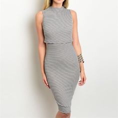 "Grey & Ivory Striped Dress Adorable grey and ivory striped pencil dress with side cut outs. 48% rayon, 48% polyester, 4% spandex. This is a tighter fit but has a lot of give/stretch to it. Small measures 40"" long and fits a 26"" waist. Dresses"