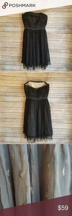 """Anthropologie Black Prom Dress w/ Gold Dots (S) Anthropologie Black Prom Dress w/ Gold Dots (S)  Be the belle of your ball in this mature and sophisticated dress from Anthropologie. This dress is in fantastic condition and features black tulle with a layer of sparkling gold polka dots underneath. Go elegant with a pair of patent black heeled sandals or show your wild side and pair with hot pink pumps!   Measurements (Lying flat): Chest: 14"""" Length (including straps): 35""""  viscose shell…"""