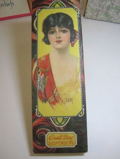 1920's Bull Dog Suspenders box pretty 1920's female with hair comb and egyptian revival deco