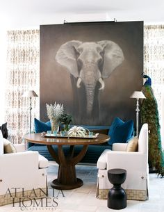 Deep pacific blue upholstered bench Against a sepia tone print of majestic elephant - exotic