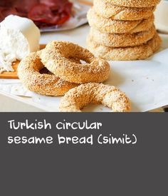 Turkish circular sesame bread (simit) | This circular, sesame seed-coated bread has been baked in Istanbul since the 1500s. Today, similar versions are enjoyed from Greece to Bulgaria and Lebanon, with its size and texture (crunchy or chewy) varying from region to region. Traditionally eaten as a snack or as part of a breakfast spread, simit goes well with chunks of feta or tulum cheese, slices of cucumber, tomato, olives and basturma (air-dried, cured and spiced beef).