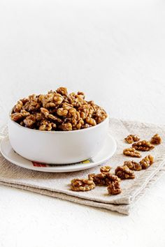 Candied walnuts are a sweet crunchy party snack. They're also a flavorful topping for summer salads like watermelon arugula salad, and strawberry spinach salad. Enjoy them on ice cream, yogurt, and honey walnut shrimp. Toss them into a batch of salted popcorn. Yum! Assemble these easy glazed walnuts in 10 minutes flat. Save this easy recipe now for later! Dessert For Two, Desserts For A Crowd, Easy Desserts, Dessert Recipes, Glazed Walnuts, Candied Walnuts, Easy Delicious Recipes, Yummy Food, Quick Recipes
