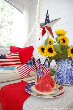 Screened-in Porch Decorated for the 4th of July and Memorial Day holiday by Between Naps on the Porch