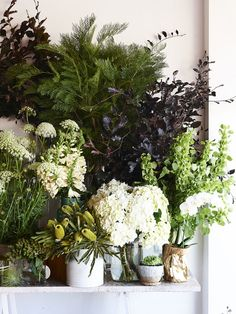 To add interest, team blooms and leafy greens of varying textures and tones together in unusual vessels #flowers #vases #display