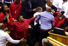 Economic Freedom Fighters MPs fight with security services who were ordered to throw them out of Parliament in Cape Town, South Africa, May 17, 2016.  Image by: Esa Alexander
