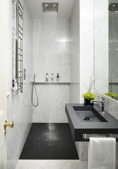 In the master bathroom, traditional statuary marble is juxtaposed with a black corian for a clean, masculine look.